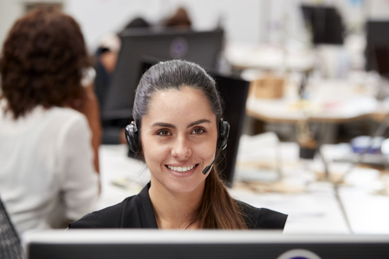 portrait-of-female-customer-services-agent-working-