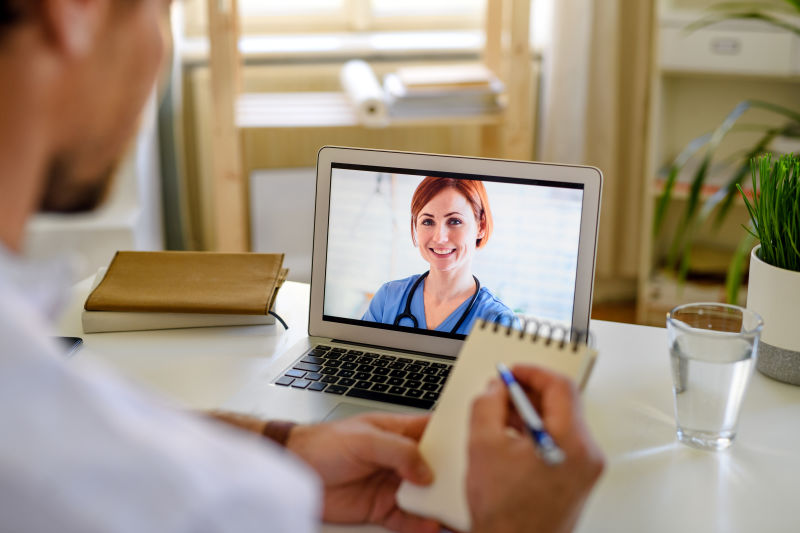 man-having-video-call-with-doctor-a-BS5WCAZ (1)